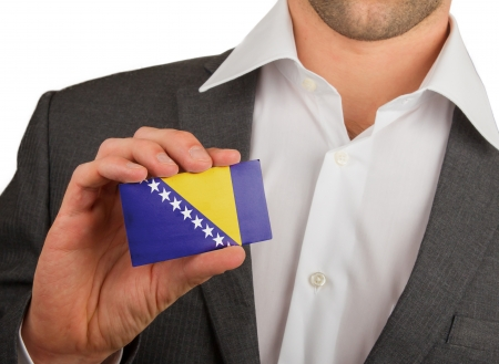 Businessman is holding a business card, flag of Bosnia and Herzegovina Stock Photo - 18031079