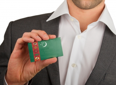 Businessman is holding a business card, flag of Turkmenistan Stock Photo - 18031082