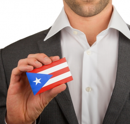 patiotic: Businessman is holding a business card, flag of Puerto Rico