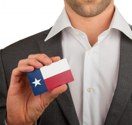 patiotic: Businessman is holding a business card, flag of Texas