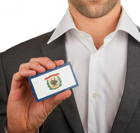 patiotic: Businessman is holding a business card, flag of West Virginia