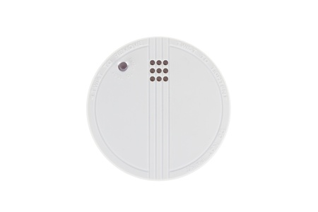 firealarm: Small round battery operated device to warn residents of fire, isolated on white