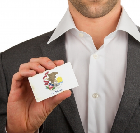 patiotic: Businessman is holding a business card, flag of Illinois Stock Photo