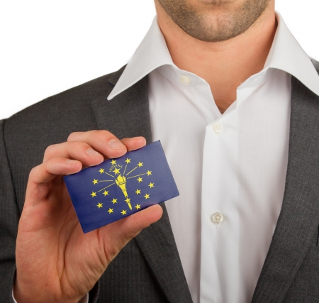 patiotic: Businessman is holding a business card, flag of Indiana Stock Photo