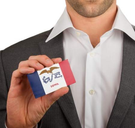 patiotic: Businessman is holding a business card, flag of Iowa