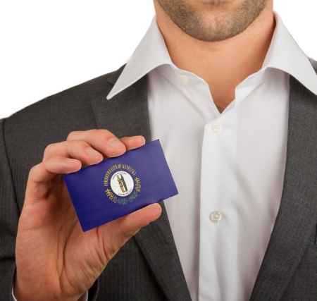 patiotic: Businessman is holding a business card, flag of Kentucky