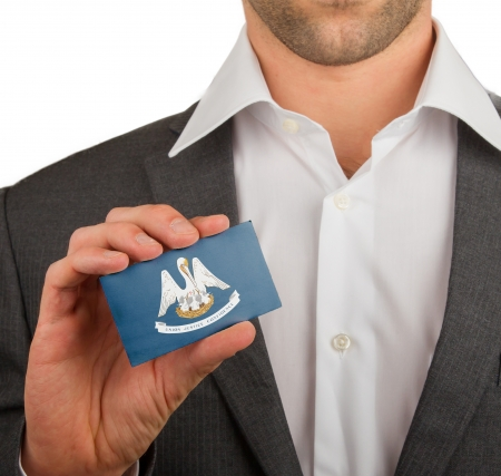 Businessman is holding a business card, flag of Louisiana