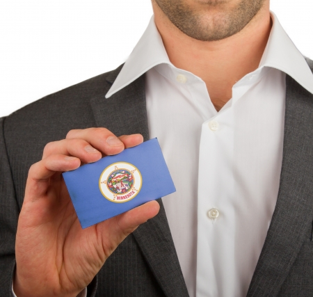 patiotic: Businessman is holding a business card, flag of Minnesota