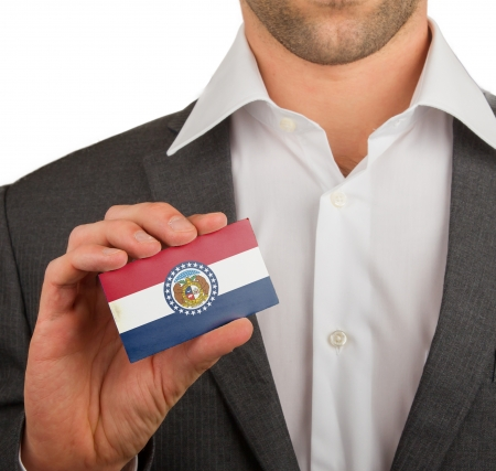 patiotic: Businessman is holding a business card, flag of Missouri Stock Photo
