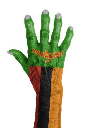 zambia: Hand of an old woman wrapped in flag of Zambia