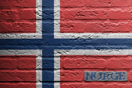 norwegian flag: Brick wall with a painting of a flag isolated, Norway Stock Photo