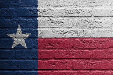 Brick wall with a painting of a flag isolated, Texas Stock Photo