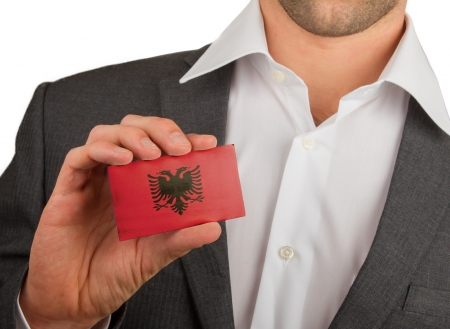 Businessman is holding a business card, flag of Albania Stock Photo - 18050625