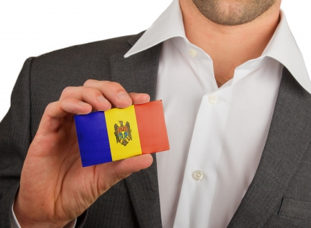 Businessman is holding a business card, flag of Andorra Stock Photo - 18050601