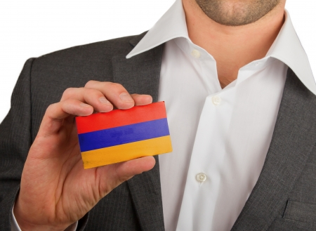 Businessman is holding a business card, flag of Armenia Stock Photo - 18050621