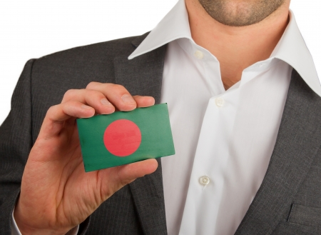 Businessman is holding a business card, flag of Bangladesh Stock Photo - 18050600