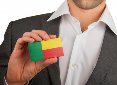 Businessman is holding a business card, flag of Benin Stock Photo - 18050599