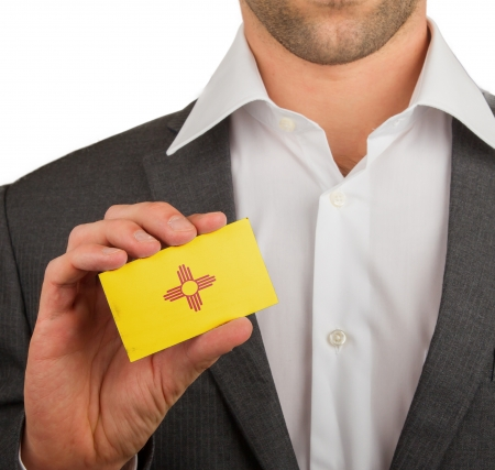 patiotic: Businessman is holding a business card, flag of New Mexico