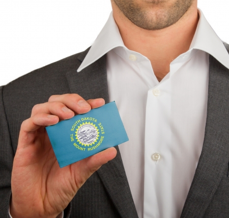 patiotic: Businessman is holding a business card, flag of South Dakota