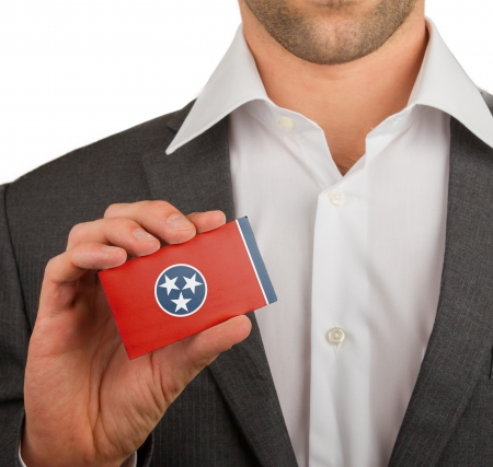 patiotic: Businessman is holding a business card, flag of, Tennessee