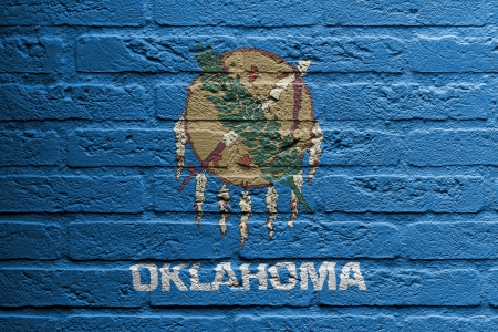 Brick wall with a painting of a flag isolated, Oklahoma