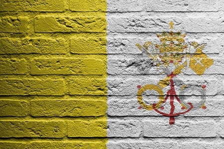 brick and mortar: Brick wall with a painting of a flag isolated, Vatican City
