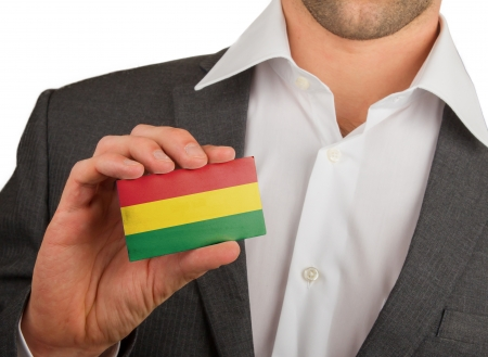 Businessman is holding a business card, flag of Bolivia Stock Photo - 18165434