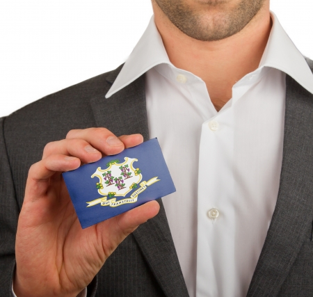 patiotic: Businessman is holding a business card, flag of Connecticut