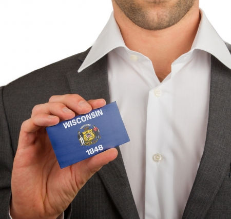 patiotic: Businessman is holding a business card, flag of Wisconsin