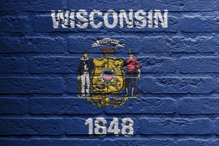 wisconsin flag: Brick wall with a painting of a flag isolated, Wisconsin