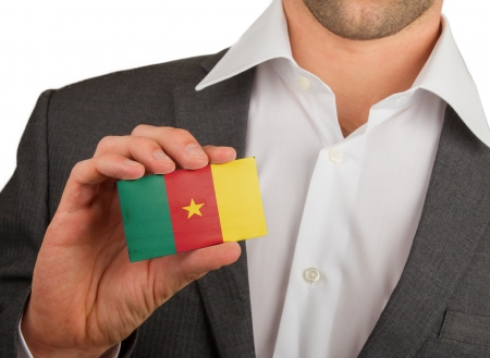 Businessman is holding a business card, flag of Cameroon Stock Photo - 18213474