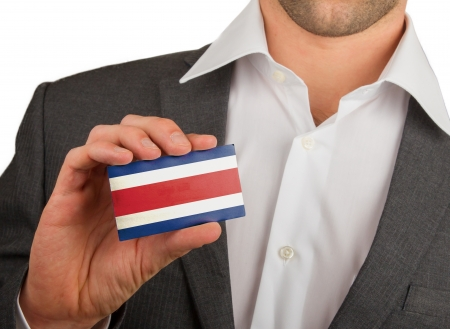 Businessman is holding a business card, flag of Costa Rica Stock Photo - 18213475