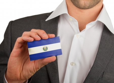 Businessman is holding a business card, flag of El Salvador Stock Photo - 18213485