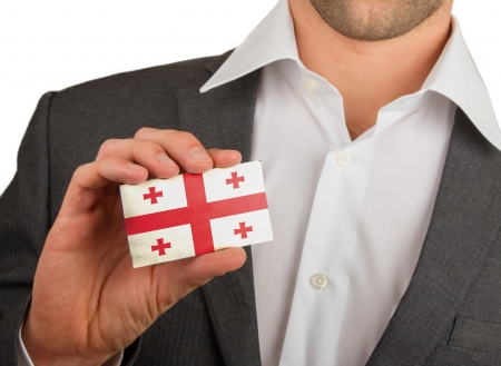 Businessman is holding a business card, flag of Georgia Stock Photo - 18213473