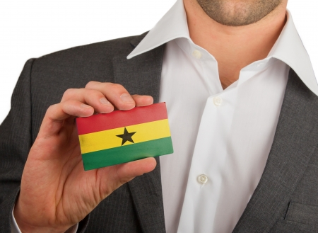 Businessman is holding a business card, flag of Ghana Stock Photo - 18213479
