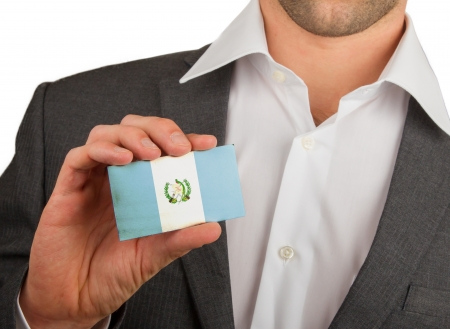 Businessman is holding a business card, flag of Guatamala
