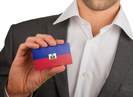 Businessman is holding a business card, flag of Haiti Stock Photo - 18213489