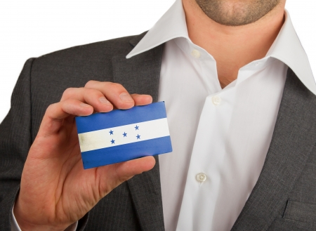 Businessman is holding a business card, flag of Honduras Stock Photo - 18213478