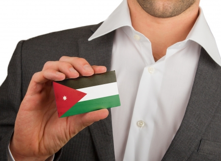 Businessman is holding a business card, flag of Jordan Stock Photo - 18213476