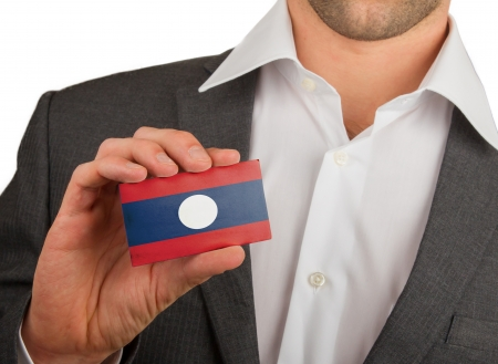 Businessman is holding a business card, flag of Laos Stock Photo - 18213481