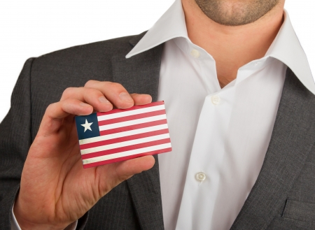 Businessman is holding a business card, flag of Liberia Stock Photo - 18213477