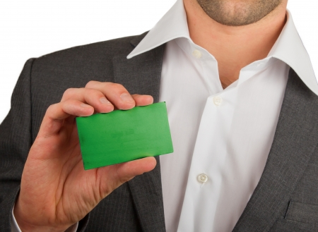Businessman is holding a business card, flag of Libya Stock Photo - 18213483