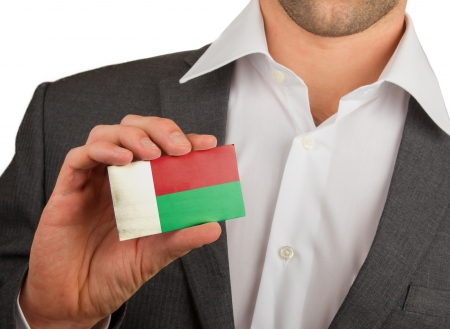 Businessman is holding a business card, flag of Madagascar Stock Photo - 18213486