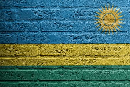 rwanda: Brick wall with a painting of a flag isolated, Rwanda Stock Photo