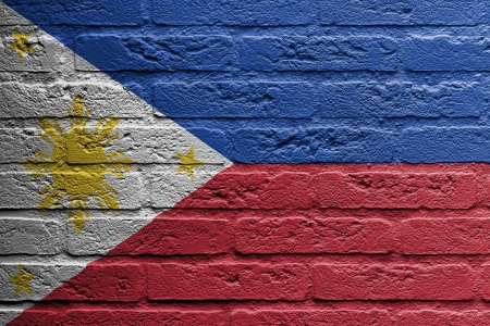 philippines flag: Brick wall with a painting of a flag isolated, The Philippines Stock Photo