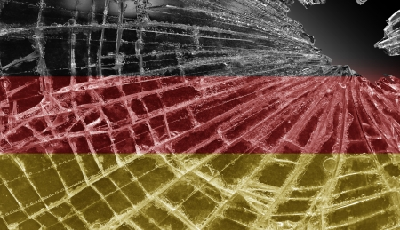Broken ice or glass with a flag pattern, isolated, Germany Stock Photo - 18248312
