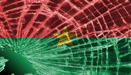 differential focus: Isolated broken glass or ice with a flag, Burkina Faso Stock Photo