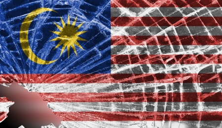 differential focus: Isolated broken glass or ice with a flag, Malaysia Stock Photo