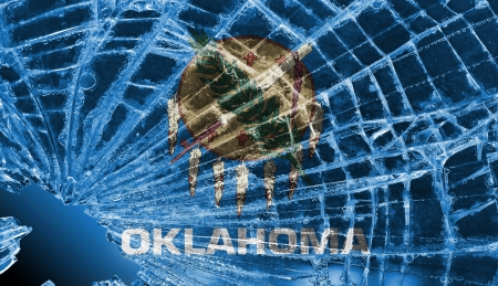 differential focus: Isolated broken glass or ice with a flag, Oklahoma Stock Photo