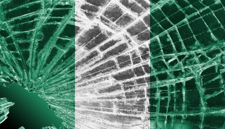 differential focus: Isolated broken glass or ice with a flag, Nigeria Stock Photo